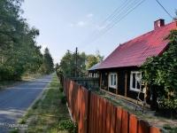 Drewniana zabudowa w nadliswarciańskich wsiach